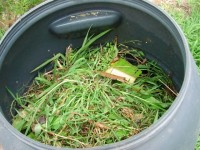 The tumbling compost bin filled with raw materials