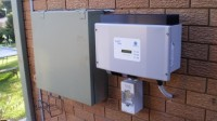 The Sunny Boy 1100 inverter is mounted next to our existing meter box.